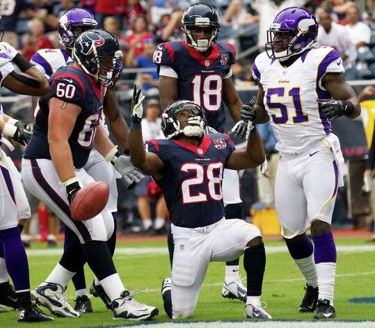 Texans running back Justin Forsett (28) celebrates his 3-yard touchdown run in the opening quarter against the Vikings. Forsett added a 5-yarder in the final quarter that was the difference in the win. Photo: Brett Coomer / © 2012  Houston Chronicle