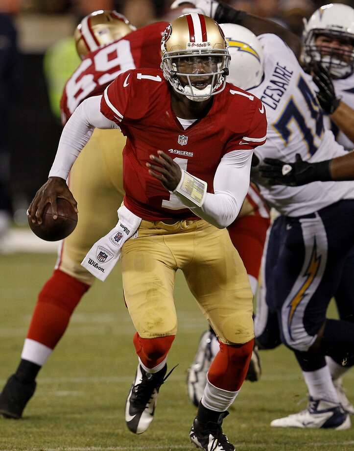 Josh Johnson dashed for a first down in the fourth quarter. The San Francisco 49ers vs the San Diego Chargers in the final exhibition game Thursday August 30, 2012 at Candlestick Park in San Francisco, Calif. The 49ers won 35-3. Photo: Brant Ward, The Chronicle