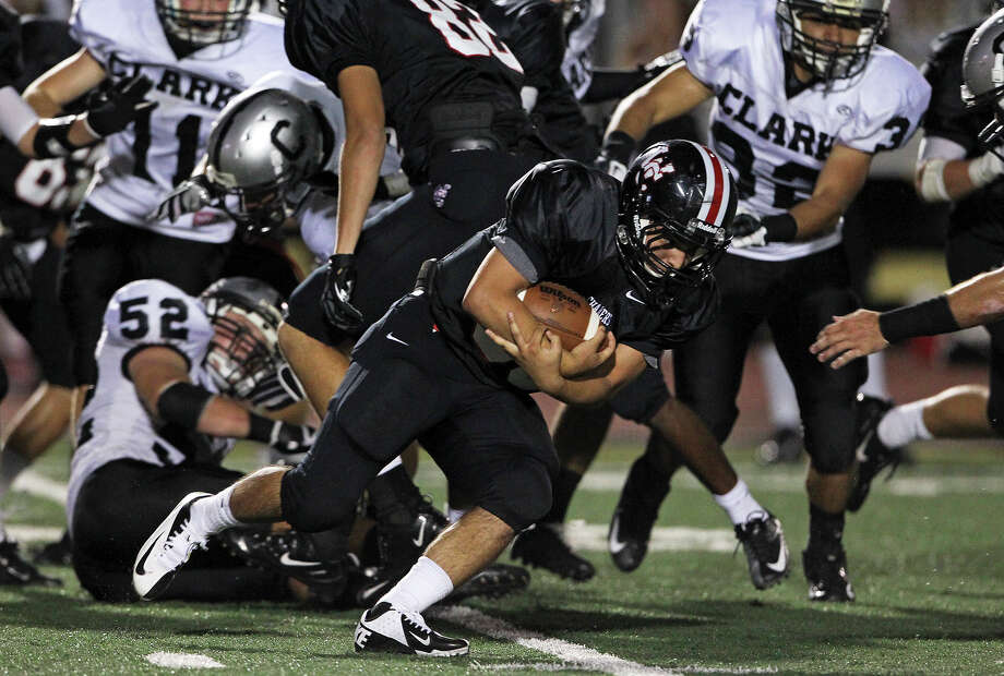 Charger running back Ricky Ramon ducks under the line in the second half as Churchill hosts Clark in the Gucci Bowl at Comalander Stadiumon August 30, 2012. Photo: Tom Reel, Express-News / ©2012 San Antono Express-News