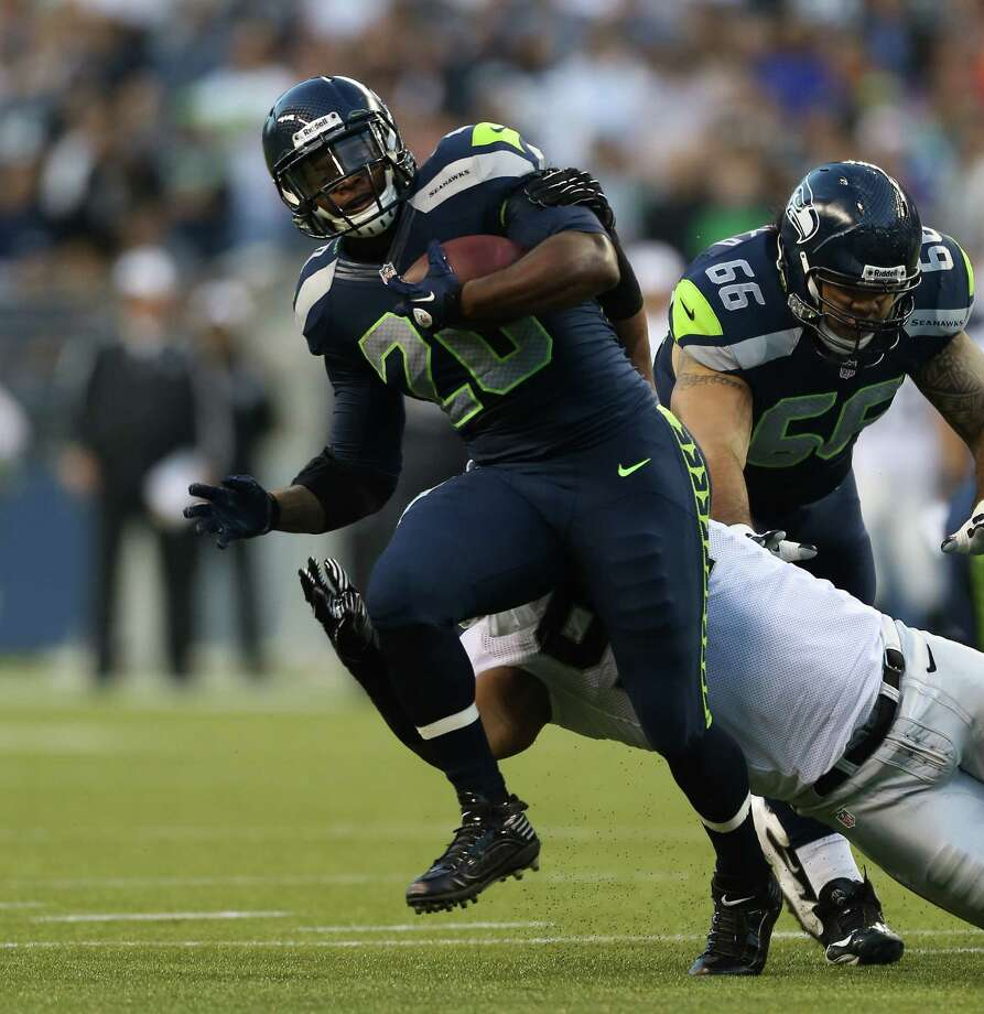 Running back Kregg Lumpkin #20 of the Seattle Seahawks rushes against Jack Crawford  #91 of the Oakland Raiders at CenturyLink Field on August 30, 2012 in Seattle, Washington. Photo: Otto Greule Jr, Getty Images / 2012 Getty Images