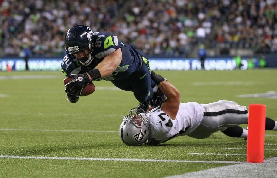 Cooper Helfet #84 of the Seattle Seahawks scores a touchdown against Chad Kilgore #47 of the Oakland Raiders at CenturyLink Field on August 30, 2012 in Seattle, Washington. Photo: Otto Greule Jr, Getty Images / 2012 Getty Images