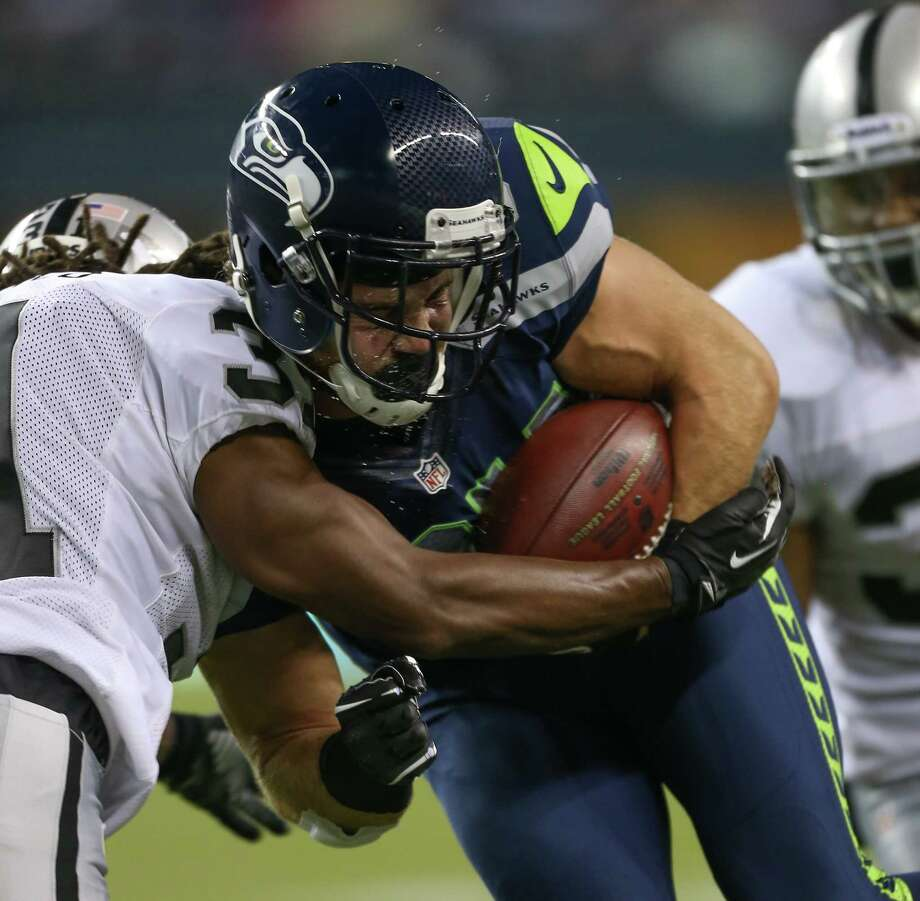 Tight end Cooper Helfet #84 of the Seattle Seahawks rushes against Coye Francies #31 of the Oakland Raiders at CenturyLink Field on August 30, 2012 in Seattle, Washington.   The Seahawks defeated the Raiders 21-3. Photo: Otto Greule Jr, Getty Images / 2012 Getty Images