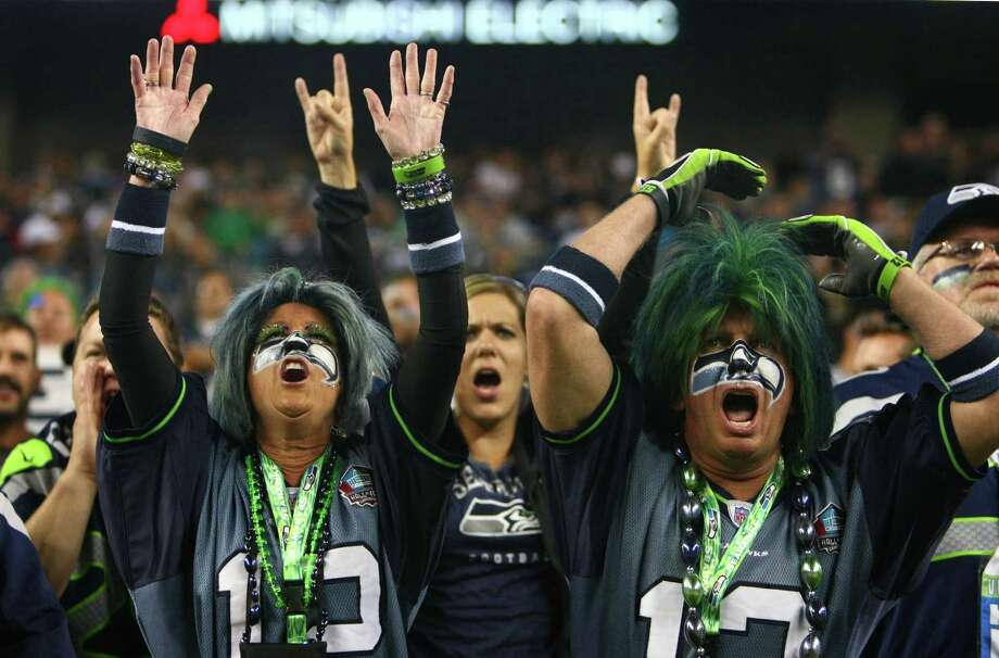Seattle Seahawks fans Jeff and Dede Schumaier cheer for their team against the Oakland Raiders during a preseason game on Thursday, August 30, 2012 at CenturyLink Field in Seattle. The Hawks defeated the Raiders 21 to 3. Photo: JOSHUA TRUJILLO / SEATTLEPI.COM