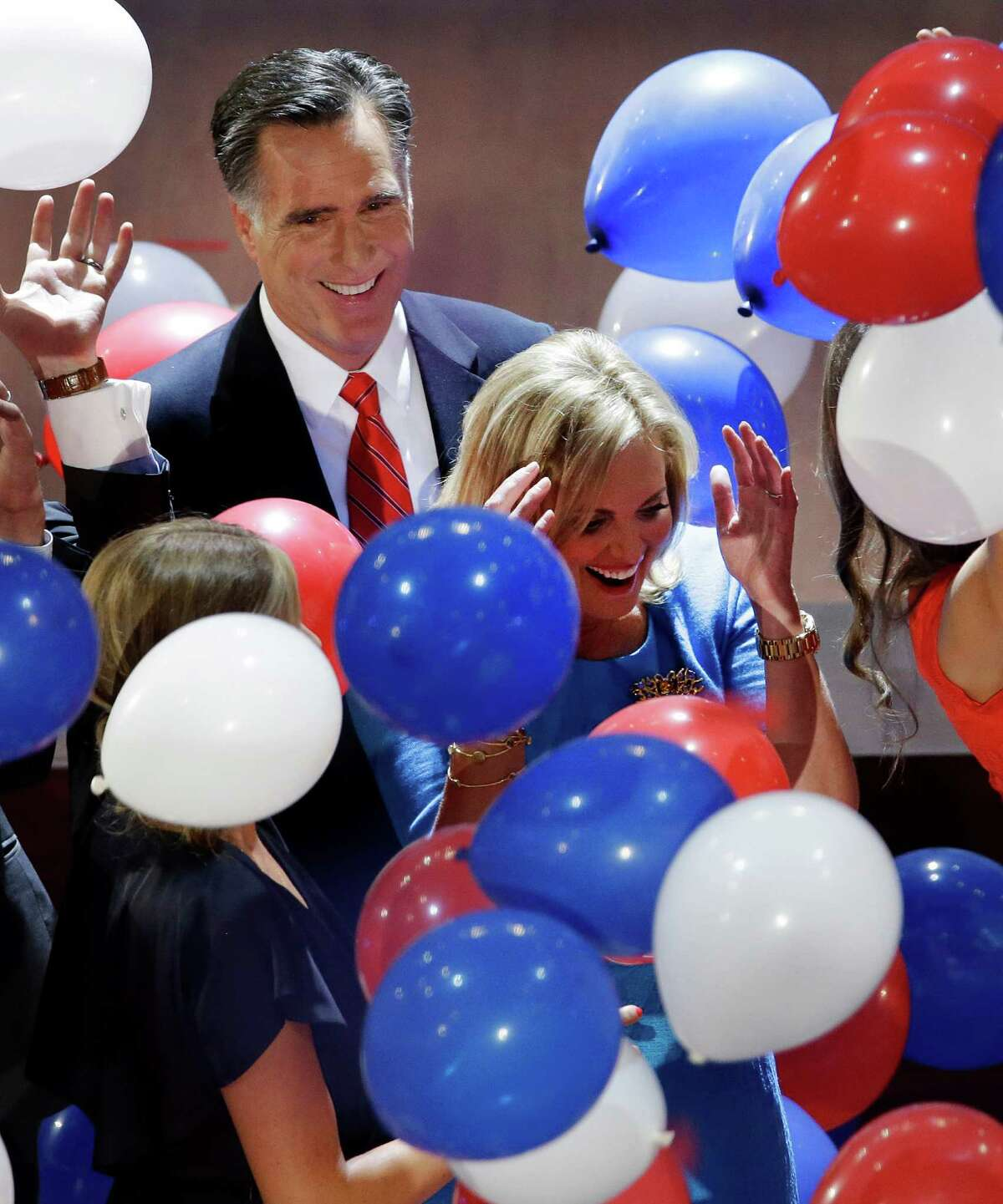 Republican presidential nominee Mitt Romney watches as balloons fall around him and his wife Ann during the Republican National Convention in Tampa, Fla., on Friday, Aug. 31, 2012.