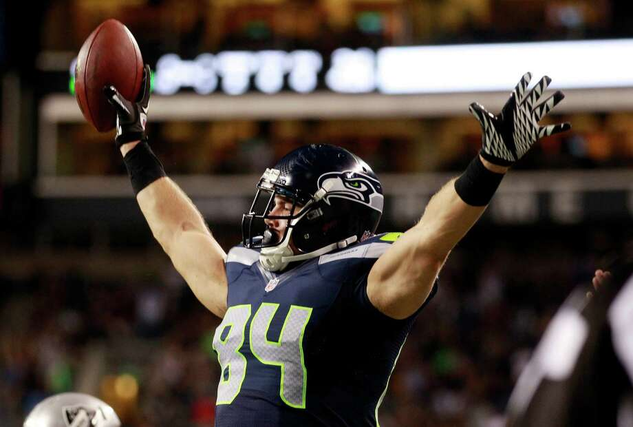 Seattle Seahawks' Cooper Helfet reacts after scoring a touchdown against the Oakland Raiders in the second half of a preseason NFL football game Thursday, Aug. 30, 2012 in Seattle. Photo: AP