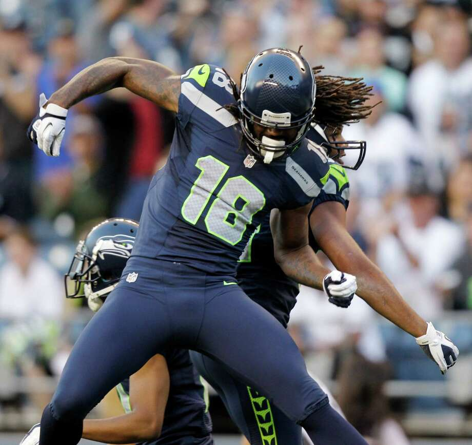 Seattle Seahawks' Sidney Rice celebrates a play with a teammate against the Oakland Raiders in the first half of a preseason NFL football game Thursday, Aug. 30, 2012 in Seattle. Photo: AP