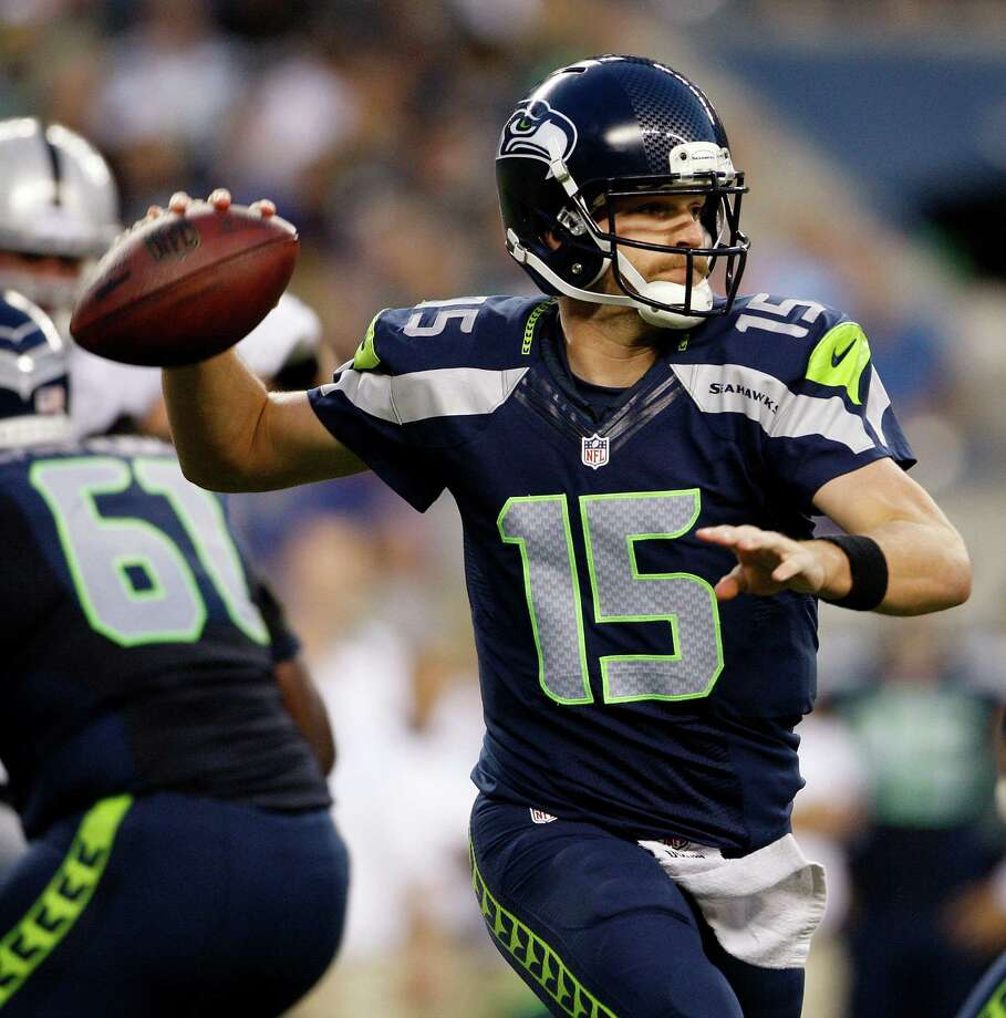 Seattle Seahawks quarterback Matt Flynn passes against the Oakland Raiders in the first half of a preseason NFL football game Thursday, Aug. 30, 2012 in Seattle. The Seahawks won 21-3. Photo: AP
