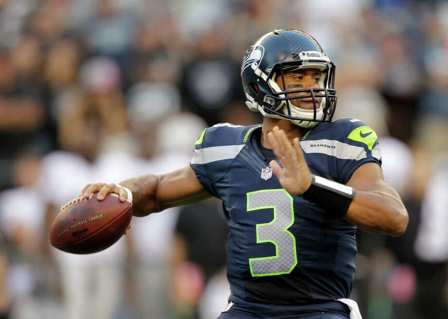 Seattle Seahawks quarterback Russell Wilson drops back to pass against the Oakland Raiders in the first half of a preseason NFL football game Thursday, Aug. 30, 2012 in Seattle. The Seahawks won 21-3. Photo: AP