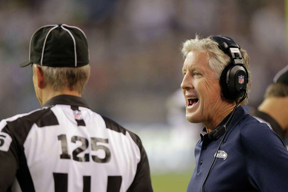 Seattle Seahawks head coach Pete Carroll talks with referees during the first half of a preseason NFL football game against the Oakland Raiders Thursday, Aug. 30, 2012 in Seattle. Photo: AP