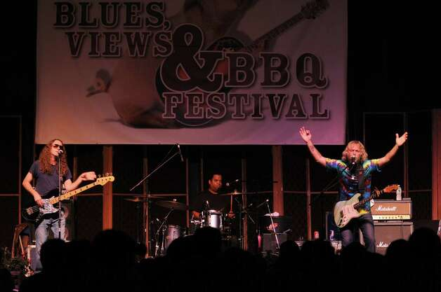 Musician Anders Osborne, right, performas at the 2011 Blues, Views & BBQ Festival in Westport, Conn. He will return for the 2012 festival, along with a lineup of other top blues musicians including Popa Chubby, James Montgomery and Billy Squier. The event, which also features plenty of food and activities, will take place on the grounds of the Westport Library and Levitt Pavilion, Saturday to Sunday, Sept. 1-2. For more information, visit www.bluesviewsbbq.com. Photo: Contributed Photo