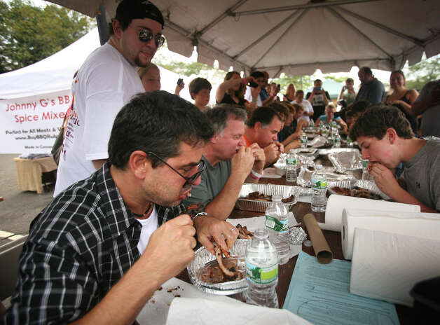 The fifth annual Blues, Views & BBQ Festival, set for Sept. 1-2, 2012, in Westport, Conn., will again feature a rib eating contest. Here, contestants in last year's competition chow down in the hopes of becoming the winner. In addition to the eating contests (there's a pie eating one, as well), there will be barbecue competitions, two days of live music and activities for all ages. For more information, visit www.bluesviewsbbq.com. Photo: Staff File Photo/Brian A. Pounds, Brian A. Pounds / Connecticut Post