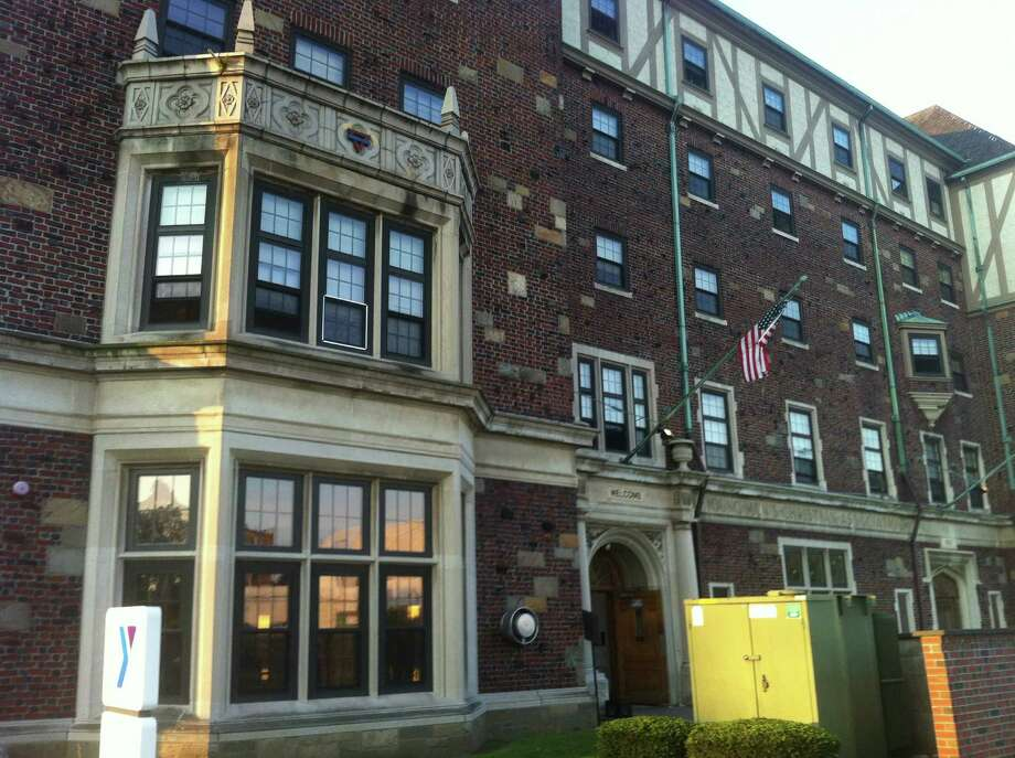 The YMCA in Bridgeport, Conn. was damaged early in the morning of Friday, Aug. 31, 2012 when a small fire in a fourth-floor apartment in the building set off the building's sprinkler system. Photo: Ben Doody