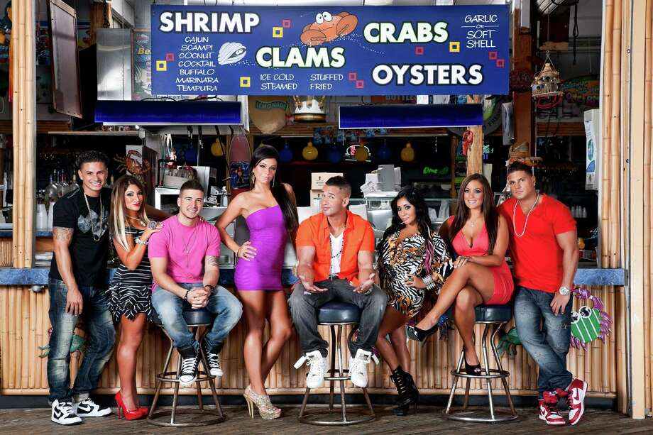 "This undated image released by MTV shows the cast of ""Jersey Shore,"" from left, Paul "" DJ Pauly D"" Delvecchio, Deena Nicole Cortese,  Vinny Guadagnino, Jenni ""JWOWW"" Farley,  Mike ""The Situation"" Sorrentino, Nicole ""Snooki"" Polizzi,  Sammi ""Sweetheart"" Giancola and Ronnie Magro in Seaside Heights, N.J. MTV gave the last call for ""Jersey Shore"" on Thursday, Aug. 30, saying the raucous reality show will conclude after its upcoming sixth season, which begins Oct. 4. The series, whose roots lay in a party house in Seaside Heights, N.J., gave rise to such stars as Nicole ""Snooki"" Polizzi and Mike ""The Situation"" Sorrentino, while popularizing the terms ""guido"" and ""guidette.""  (AP Photo/MTV, Ian Spanier Photography) Photo: Ian Spanier Photography"
