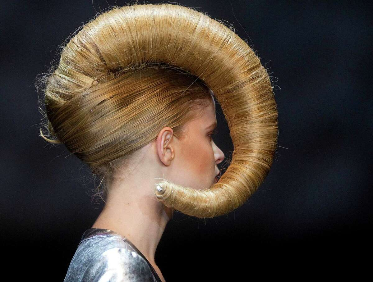 A model displays a creation by hair stylist Julio Crepaldi during the Hair Fashion Show in Sao Paulo, Brazil, Thursday, Aug. 30, 2012.