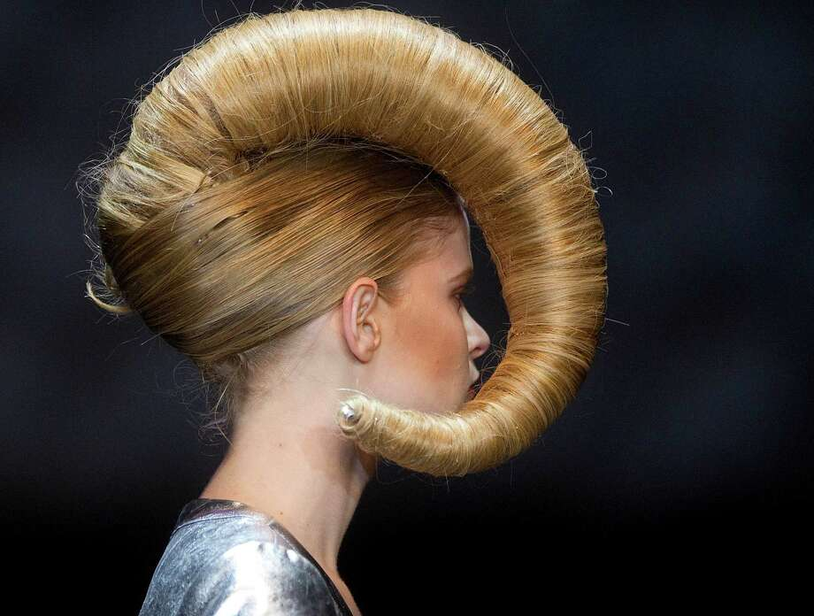 A model displays a creation by hair stylist Julio Crepaldi during the Hair Fashion Show in Sao Paulo, Brazil, Thursday, Aug. 30, 2012. Photo: Andre Penner, AP / AP