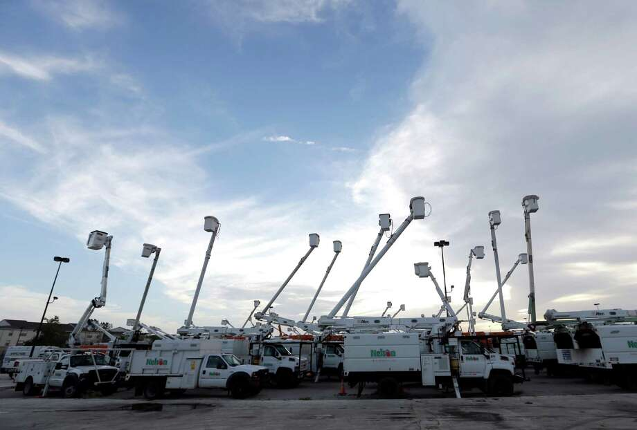 Utility trucks stage outside New Orleans as recovery efforts after Hurricane Isaac continue in New Orleans, Friday, Aug. 31, 2012. Isaac is now a tropical depression and the center was on track to cross Arkansas on Friday and southern Missouri on Friday night, spreading rain as it goes. (AP Photo/David J. Phillip) Photo: David J. Phillip, Associated Press / AP