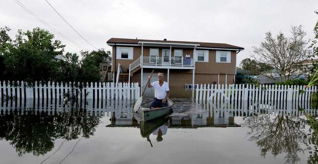 Anthony Segrave rides in his boat as he leaves his son's flooded home in the aftermath of Hurricane Isaac in Slidell, La., Friday, Aug. 31, 2012. Isaac is now a tropical depression and the center was on track to cross Arkansas on Friday and southern Missouri on Friday night, spreading rain as it goes. (AP Photo/David J. Phillip) Photo: David J. Phillip, Associated Press / AP