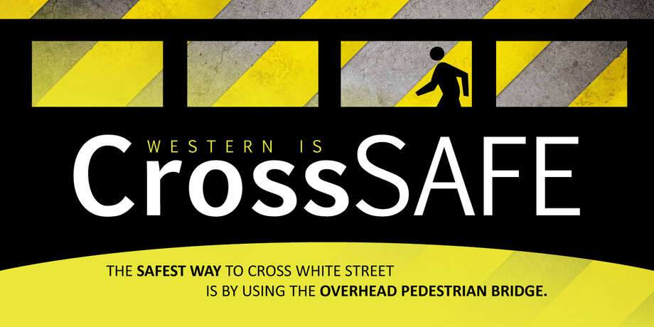 This is an example of new CrossSafe banners that WestConn has posted to remind students to use the pedestrian bridge when crossing White Street. It's part of larger efforts to improve safety on one of the main streets passing by the school. Photo: Contributed Photo