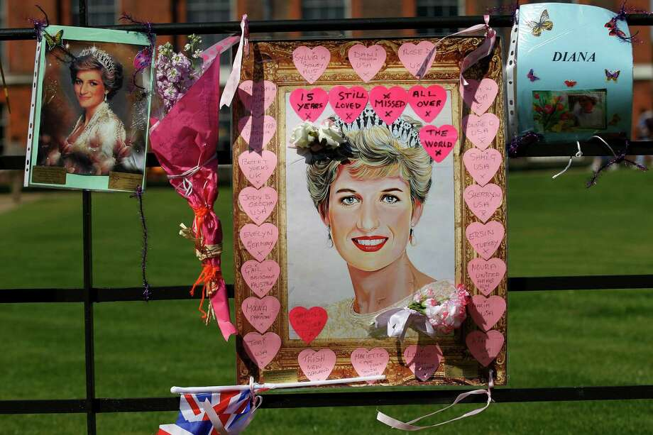Tributes for Princess Diana are displayed on the gate of Kensington Palace in London on the 15th anniversary of her death, Friday, Aug. 31, 2012. Princess Diana was killed in a car accident in Paris in 1997. (AP Photo/Sang Tan) Photo: Sang Tan, Associated Press / AP