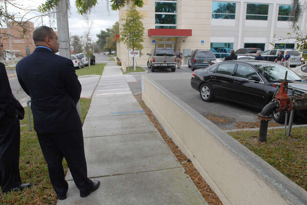 Albany County District Attorney, David Soares, waits on the sidewalk just outside Signature Compounding Pharmacy in Orlando, Fla., Feb. 27, 2007. (Paul Buckowski / Times Union archive) Photo: Paul Buckowski