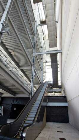 The escalator bank at the north east corner of Reliant Stadium is where a man fell from somewhere between the fifth  and third level to his death, Aug. 31, 2012, in Houston. A man in in his 20's was reported to have falen to his death when he was siting on the rail of an escalator that descended from the fifth to third level during last night's Houston Texan's preseason game. Photo: Nick De La Torre, Houston Chronicle / © 2012  Houston Chronicle