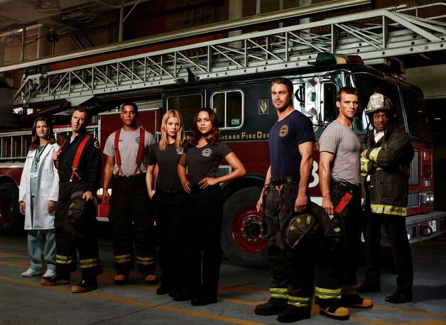 "This image released by NBC shows the case of ""Chicago Fire, "" from left, Teri Reeves as Hallie, David Eigenberg as Christopher Hermann, Charlie Barnett as Peter Mills, Lauren German as Leslie Shay, Monica Raymund as Gabriella Dawson, Taylor Kinney as Kelly Severide, Jesse Spencer as Matthew Casey and Eamonn Walker as Battalion Chief Walter Boden. The series premieres Oct. 10 at 9 p.m. on NBC. (AP Photo/NBC) Photo: AP, HOEP / NBC"