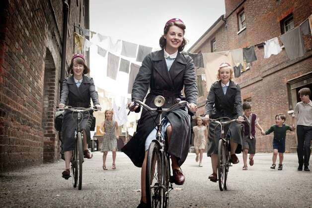 "This image provided by Neal Street Productions shows, from left, Bryony Hannah, Jessica Raine and Helen George in ""Call The Midwife, "" a British drama about midwifery in the 1950s that opens PBS' fall schedule on Sept. 30. (AP Photo/Neal Street Productions, Laurence Cendrowicz) MANDATORY CREDIT Photo: AP, HOEP / © Neal Street Productions 2011"