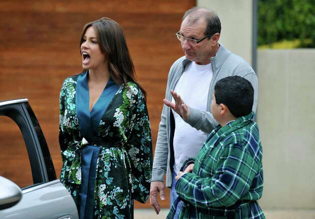 "In an undated file photo released by ABC, from left, Sofia Vergara portrays Gloria, left, Ed O'Neill portrays her husband Jay, and Rico Rodriguez portrays her son Manny in a scene from ""Modern Family."" For the fall 2012 schedule, there is a resurgence of situation comedies on network television, such as ABC's critical hit and most popular scripted program, ""Modern Family."" (AP Photo/ABC, Eric McCandless, File) Photo: AP, HONS / AP2010"