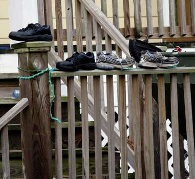 An all too frequent sight in neighborhoods affected by Hurricane Isaac, are sets of wet shoes placed on porches, stairwells and steps, as their owners attempt to dry them out after walking through flood waters to get home as in this case in Hancock County, Miss., Friday, Aug. 31, 2012. (AP Photo/Rogelio V. Solis) Photo: Rogelio V. Solis, Associated Press / AP