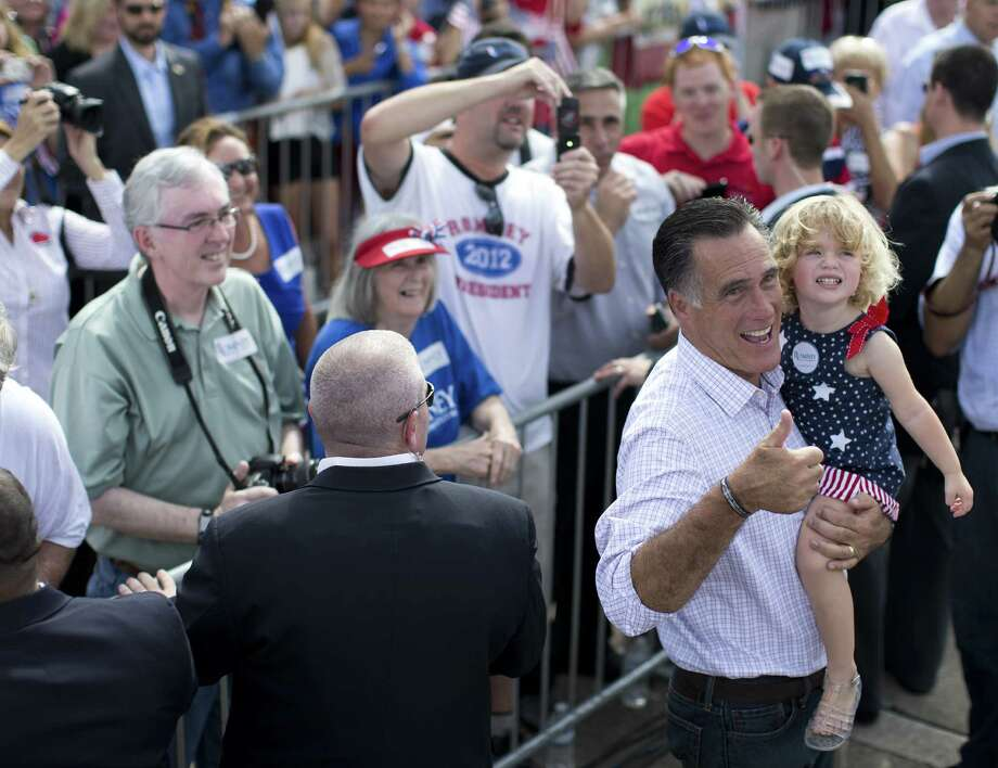 Republican presidential nominee Mitt Romney greets supporters during a campaign stop. Photo: Evan Vucci, Associated Press / AP