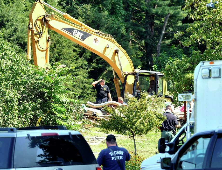 State police and fire department investigators examine and document the remains of a house that was destroyed by a gas explosion on Sunny Valley Road in New Milford. Photographed Friday, Aug. 31, 2012. Photo: Michael Duffy / The News-Times