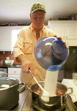 Tim Dyring adds sugar as he prepares beautyberry jelly. Photo: J. Patric Schneider, Photographer / © 2012 Houston Chronicle