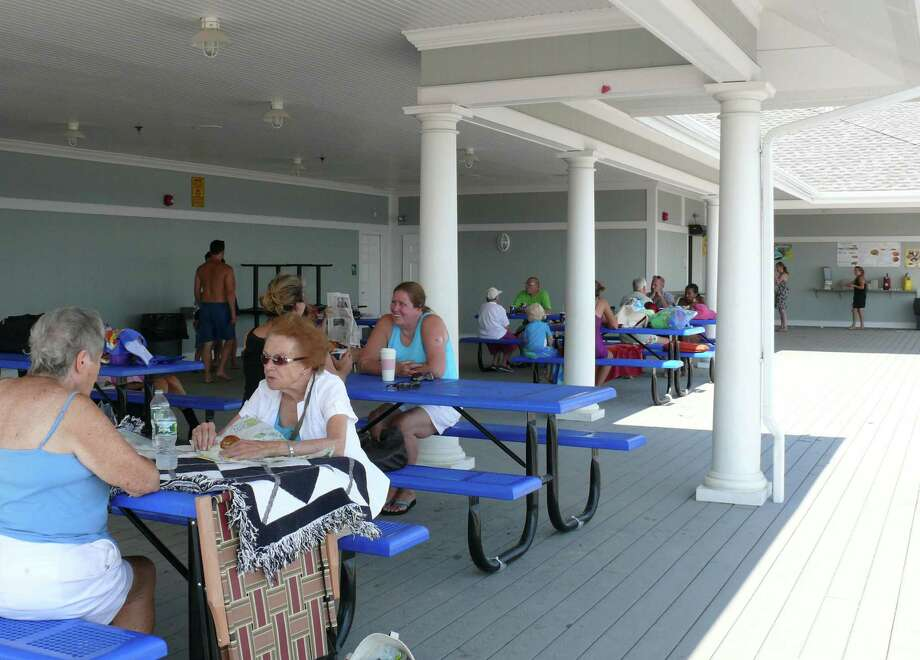 Beachgoers enjoy the new deck at Penfield Pavilion. Photo: Genevieve Reilly / Fairfield Citizen