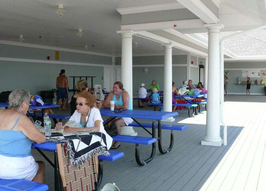 Beachgoers enjoy the new deck at Penfield Pavilion. Photo: Genevieve Reilly / Fairfield Citizen