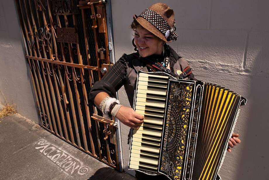 Skyler Fell, local musician and owner of the Accordion Apocalypse store, repair shop and museum. Photo: John Sebastian Russo, The Chronicle