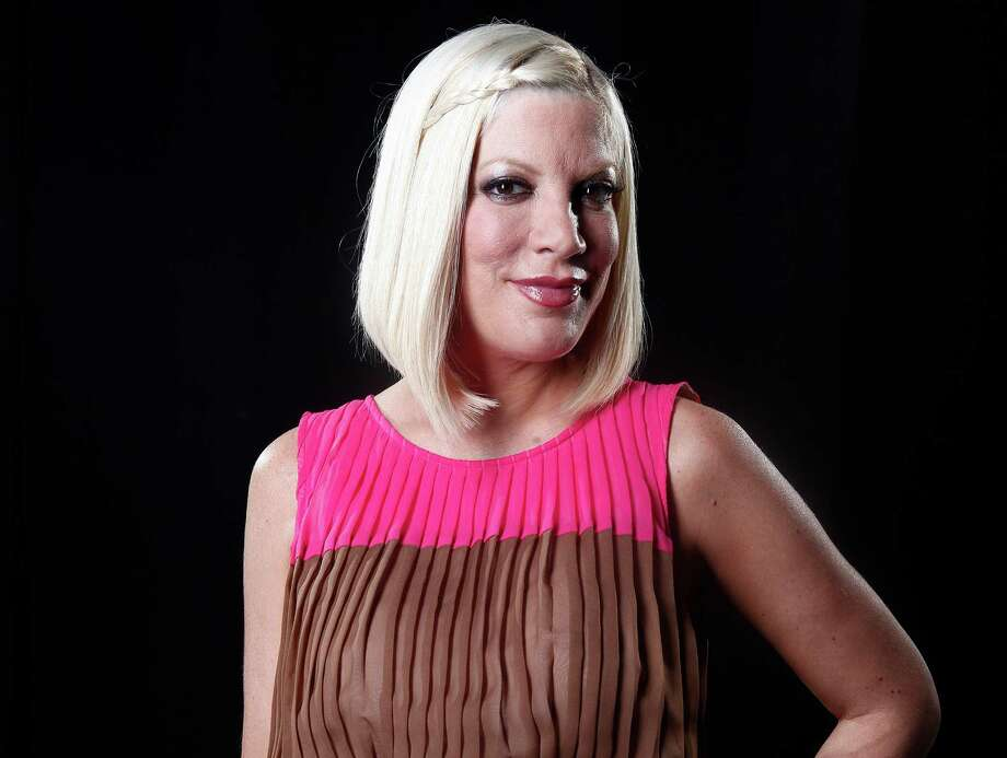 FILE - In this April 3, 2012 file photo, actress Tori Spelling poses for a portrait in New York. Spelling has given birth to her fourth child, a son named Finn. The actress announced on Thursday, Aug. 30, 2012, the birth on her official website and Twitter account. (AP Photo/Carlo Allegri, File) Photo: Carlo Allegri