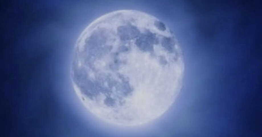 """A """"blue moon"""" -- the second full moon of August -- can be see over southwestern Connecticut tonight shortly after 7 p.m. Photo: Contributed Photo / Fairfield Citizen contributed"""