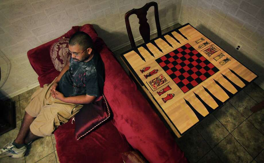 Michael Flores has paranoid schizophrenia and receives a monthly Social Security disability check of $698. He has lived in numerous boarding homes since his disease took hold a decade ago. Photo: BOB OWEN, San Antonio Express-News / © 2012 San Antonio Express-News