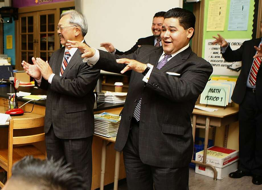 Mayor Ed Lee  (left) and the new superintendent Richard Carranza (right) visiting a classmate at Everett Middle School in San Francisco, Calif., as students introduce themselves on the first day of school on Monday, August  20, 2012. Photo: Liz Hafalia, The Chronicle