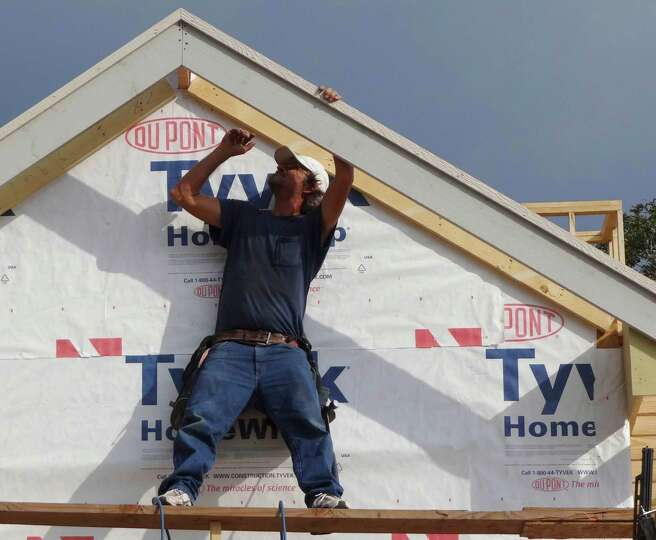 Mike Newborn works on a home under construction in in the Abrego Lake neighborhood in Floresville on