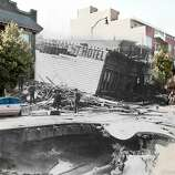 A cyclist rides by the fallen Valencia Street Hotel. Photo illustration by Shawn Clover.