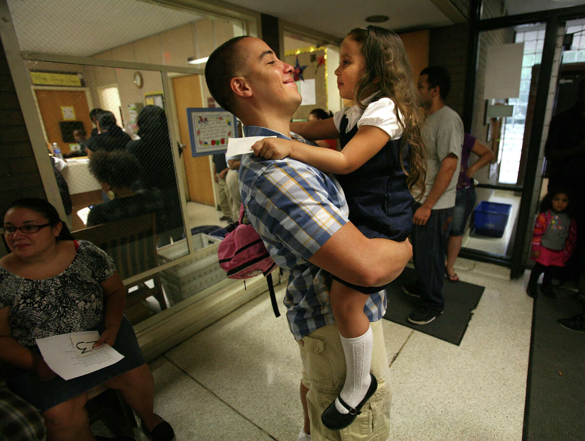 William Marin hugs his daughter, Eliana, 5, as he drops her off for her first day of first grade at Curiale School in Bridgeport on Tuesday, August 28, 2012.