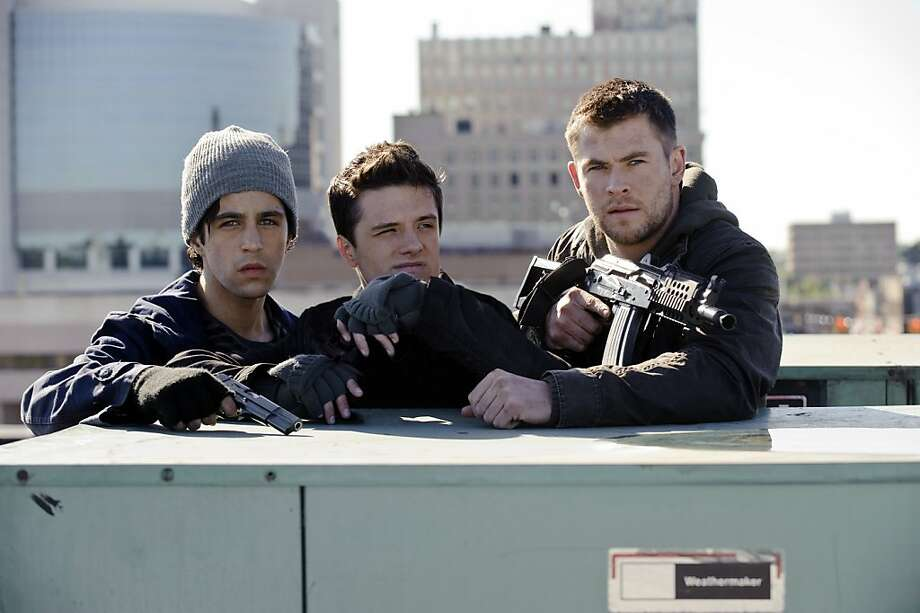 "Josh Peck (left), Josh Hutcherson and Chris Hemsworth fight for freedom in ""Red Dawn."" Photo: Ron Phillips, New York Times"