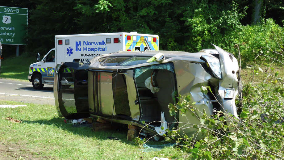 An elderly man and woman were hospitalized Friday afternoon, August 31, 2012, after their Lexus SUV rolled over on the Merritt Parkway northbound between exits 38 and 39A-B. Photo: Contributed