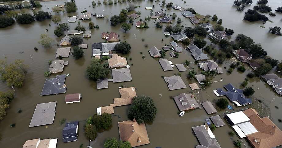 This aerial photo shows homes flooded by Isaac in Braithwaite, La., Friday, Aug. 31, 2012. Isaac is now a tropical depression, with the center on track to cross Arkansas on Friday and southern Missouri on Friday night, spreading rain through the regions. (AP Photo/David J. Phillip) Photo: David J. Phillip, Associated Press