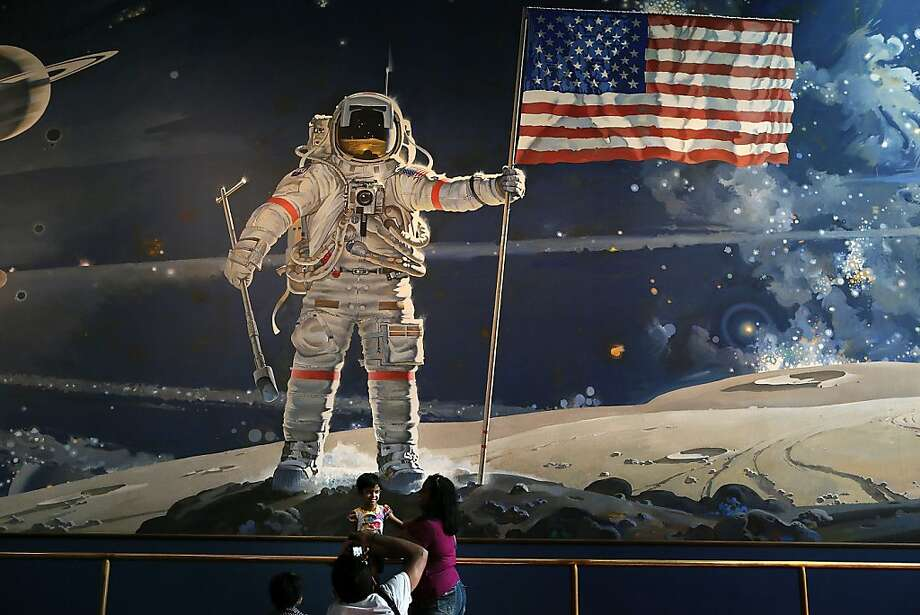 Visitors take photographs August 31, 2012 at the Smithsonian National Air and Space Museum in Washington, DC. Neil Armstrong, the first person to walk on the Moon, has died on August 25 at the age of 82. His life was celebrated at a private service today in Cincinnati, Ohio. A national memorial has been scheduled on September 12 in Washington.  (Photo by Alex Wong/Getty Images)  *** BESTPIX *** Photo: Alex Wong, Getty Images