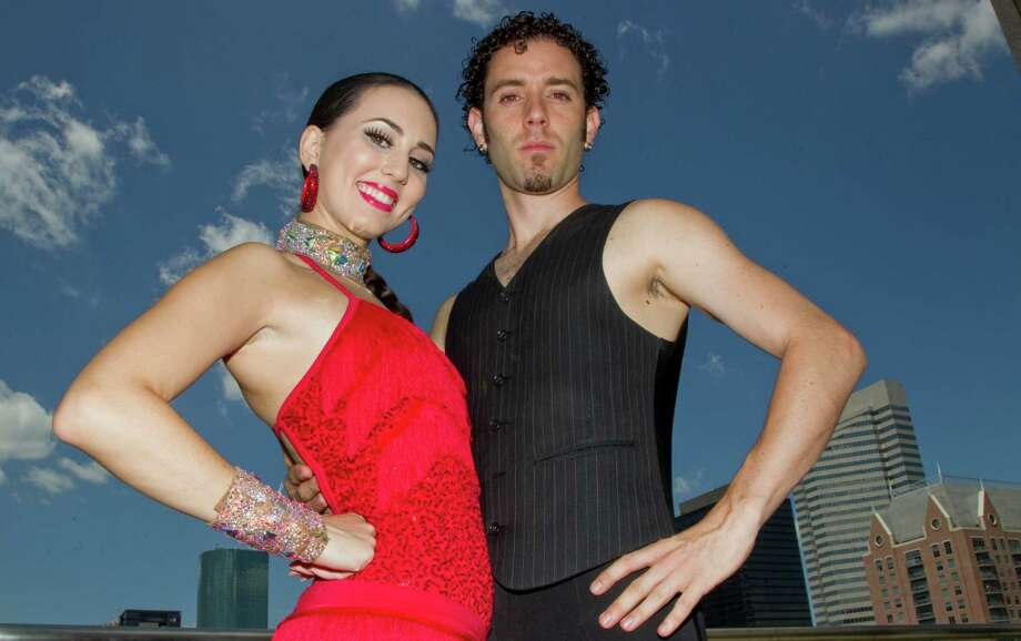 Michael Blanco with his wife Jessica Blanco. The couple known as the Rhythm of Magic will be attending the Texas Associations of Magicians Convention  at he Hilton Americas in Houston, Texas the weekend of September 1, 2012. Photo: Billy Smith II, Chronicle / © 2012 Houston Chronicle