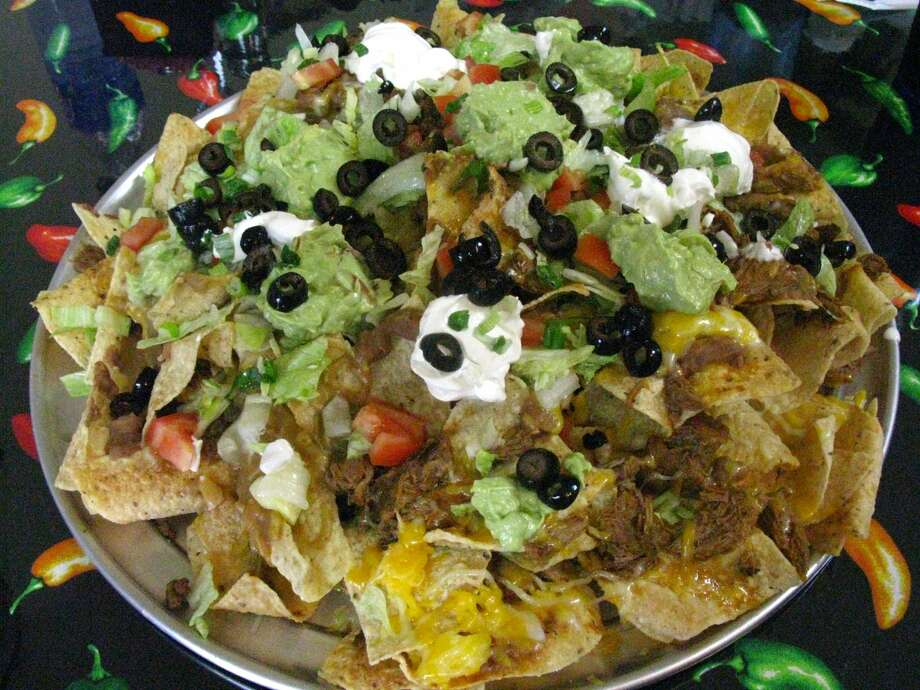 "Extreme Nachos at Marianito's Extreme Tex-Mex Grill are served on a 16-inch pizza pie pan. The restaurant at 2102 Bandera Road was featured on Food Network's ""Outrageous Food"" in 2010."