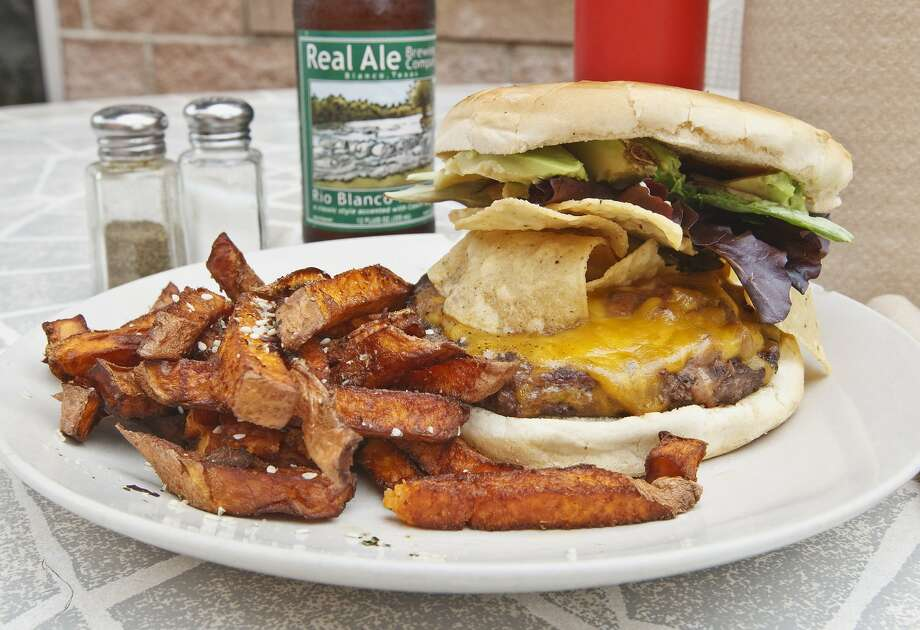 "The Cove's Texas Burger with Organic Sweet Potato Fries. The Cove,  located at 606 W. Cypress, was featured in the ""Totally Unexpected"" episode of ""Diners, Drive-Ins and Dives."" In 2009, Texas Monthly named The Cove's Texas Burger as one of the best 50 burgers in Texas."