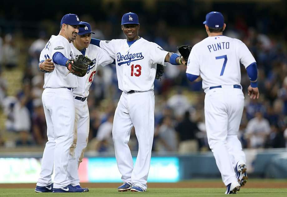 The Dodgers wish coming together was as easy as it looks after adding parts like Adrian Gonzalez (left) and Hanley Ramirez (second from right). Photo: Stephen Dunn, Getty Images